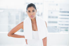 Unsmiling toned brunette holding towel Stock Photography