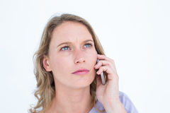 Unsmiling woman calling with her smartphone Royalty Free Stock Images
