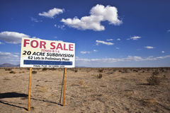 Unsold Housing Development. For sale sign for a housing development stands in the desert Stock Photos