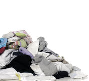 Unsorted Laundry. A pile of clean unsorted laundry, isolated against a white background Stock Images