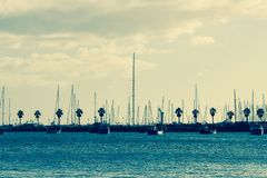 Unsplash.com – Blue Water Ocean Sailboats Palm Trees Clouds stock images