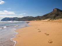 Deserted Beach, Costa Calida, Spain. Footprints on the deserted, unspoiled beach in Calblanque Regional Park and Nature Reserve on the Costa Calida. Cartagena stock image