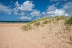 Unspoiled beach on Wild Atlantic Way, Donegal, Ireland. Landscape of empty sand beach in summer at Stocker Strand, Portsalon Royalty Free Stock Photo