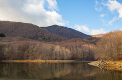 Unspoiled European wilderness. The Santa Fe lake at the Catalan Montseny massif with winter forests Stock Image