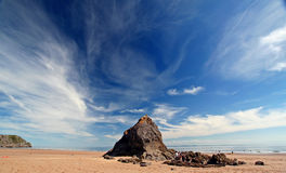Unspoilt beach landscape. Wide angle shot of sandy beach with blue sky and cirrus clouds, shot with a polarizer royalty free stock photography