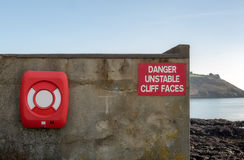 Unstable cliff, warning sign. Royalty Free Stock Photo