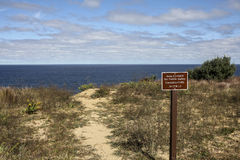 Unstable cliffs sign near Truro lighthouse Stock Images