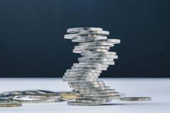 Unstable closed to collapse stack of coins tower , uncertainty o. F business, risk of financial or investment, no stability, problem or crisis concept Royalty Free Stock Image