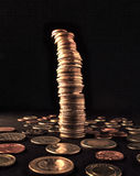 Unstable column of coins Stock Image