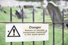 Unstable headstones memorials at burial ground gravestones danger sign. Uk stock images