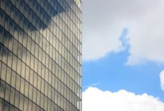 Unstable reflections of clouds on the windows of a building Royalty Free Stock Images