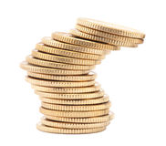 Unstable stack of golden coins Royalty Free Stock Image