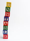 Unstable tower of blocks. Leaning on white background Stock Photos