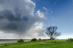Unstable weather in spring. Unstable weather near the Dutch coast in spring Royalty Free Stock Images