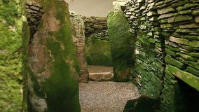 Unstan Cairn, a neolithic burial cairn in Orkney, Scotland. The Unstan Cairn, a neolithic burial cairn in Orkney, Scotland stock video footage