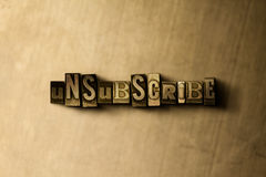 UNSUBSCRIBE - close-up of grungy vintage typeset word on metal backdrop Stock Image