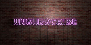 UNSUBSCRIBE - fluorescent Neon tube Sign on brickwork - Front view - 3D rendered royalty free stock picture Stock Photo