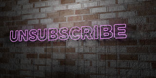 UNSUBSCRIBE - Glowing Neon Sign on stonework wall - 3D rendered royalty free stock illustration Royalty Free Stock Photography