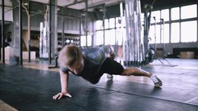 Unsuccessful attempt to push ups. Exercise for advance not for beginners. Successful attempt to push ups. Young fitness trainer performs effective push-ups one stock video footage