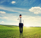 Unsuccessful man standing on the field Royalty Free Stock Photography
