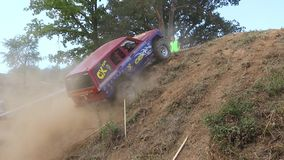Unsuccessful ride up a steep slope by an off road car stock video footage