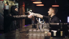 Unsuccessful robbery bar. The barman also has a gun stock video footage