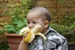 Unsure baby and banana 2 royalty free stock photos