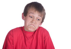 Unsure boy on white. This boy is unsure of something on white royalty free stock images