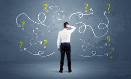Free Unsure Businessman With Question Marks Stock Photography - 81148562