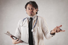 Unsure doctor doing his job royalty free stock photos