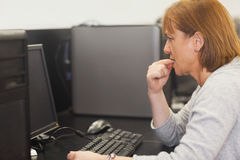 Unsure female mature student working on computer Stock Image