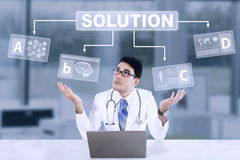 Unsure male doctor with solution. Unsure male doctor to choose a solution choice stock image