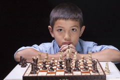 Unsure of next chess move. Royalty Free Stock Image