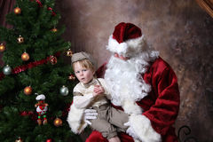 Unsure of Santa. Young Toddler Unsure of who santa is royalty free stock image