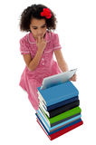 Unsure school kid using tablet pc Stock Photography