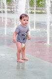 Unsure toddler in splash pad Royalty Free Stock Photo
