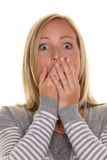 Unsuspecting woman is stunned Royalty Free Stock Photos