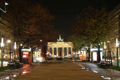 Unter den Linden street in Berlin at night. The famous Unter den Linden street in Berlin at night with the Brandenburg Gate in the background Royalty Free Stock Photo