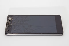 Unterbrochener Handy lizenzfreie stockfotografie