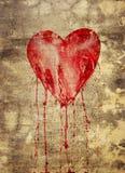 Unterbrochenes und blutendes Herz Stockbild