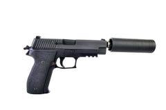 Unterdrückte Pistole mit dem gespannten Hammer bereit abzufeuern Lizenzfreies Stockfoto