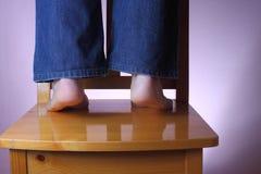 Unterhalt auf Ihren Zehen Stockbilder