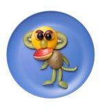 Unterhaltender Affe gemacht von den frischen Früchten Stockbilder