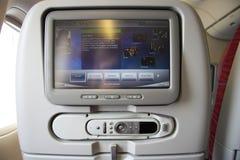 Unterhaltung in einem Flugzeug Stockbild