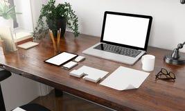 Unternehmensidentitä5selemente auf dem Desktop lizenzfreie stockfotografie