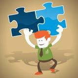 Unternehmenskerl hat die Lösung zum Puzzlespiel Stockfoto