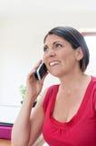 Unternehmensleiter am Telefon Stockbild