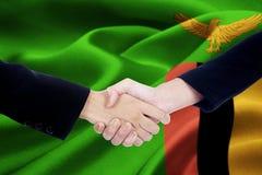 Unternehmer zwei mit Sambiaflagge Stockfotografie