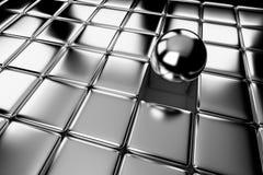 Unterschiedlicher Stahlball, der heraus in der Menge von Würfeln steht Lizenzfreies Stockfoto