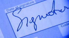 Unterschrift auf Dokument Stockbild